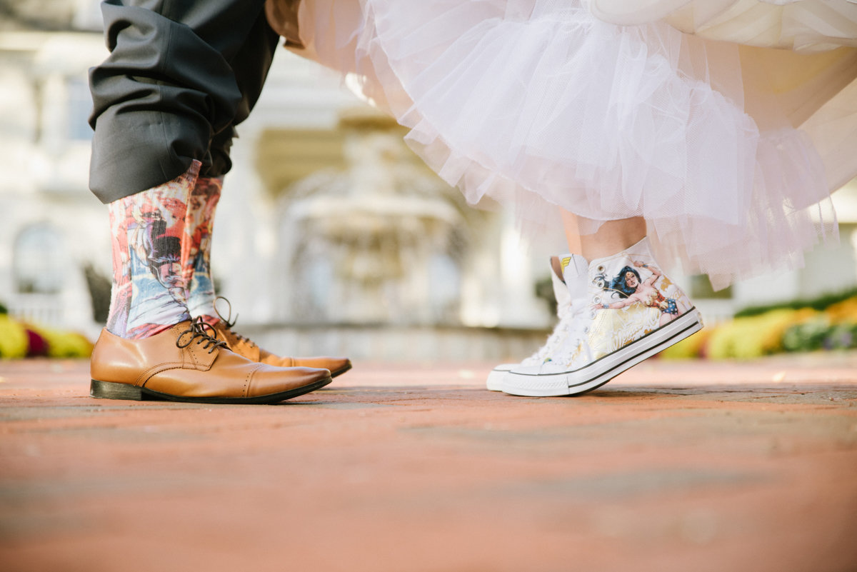 funny fun quirky unique wedding photography superheroes personality candid wedding photography tulle tippy toes shoes converse
