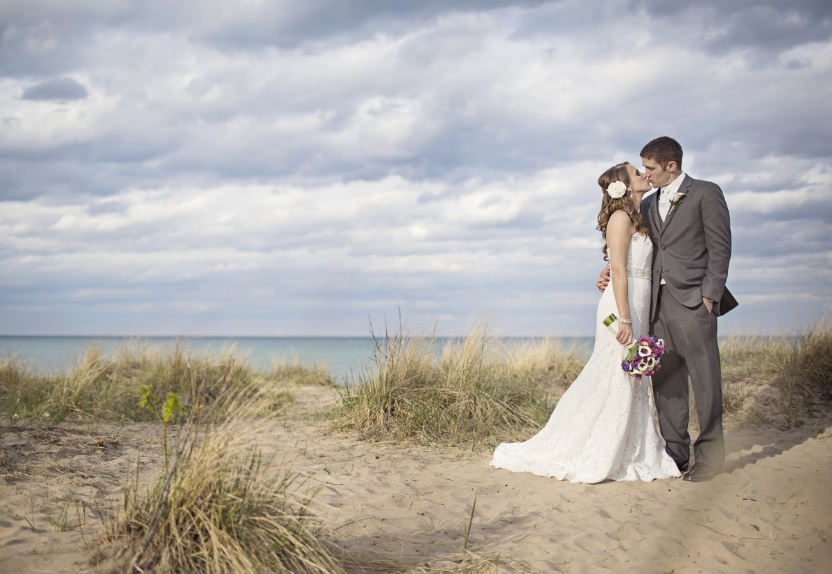 Lake Michigan wedding bride and groom kissing at Chicago wedding
