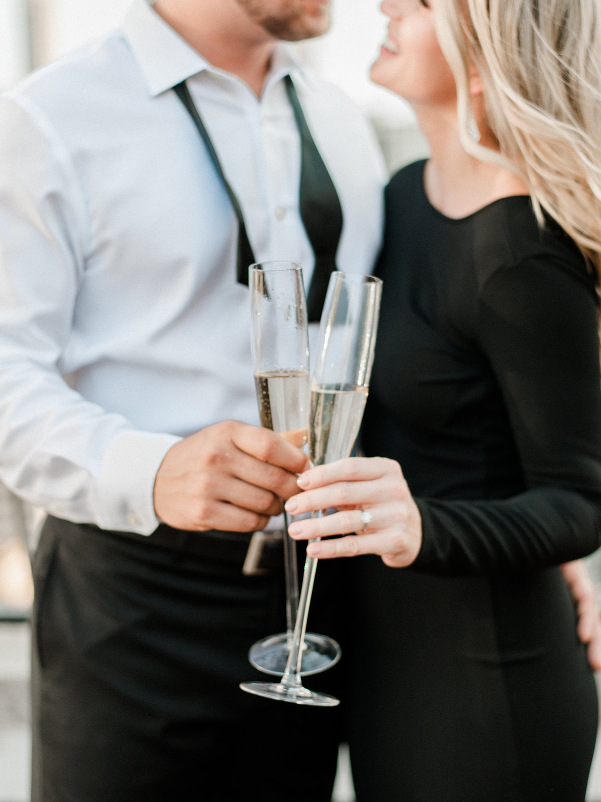 engaged couple holding champagne flutes