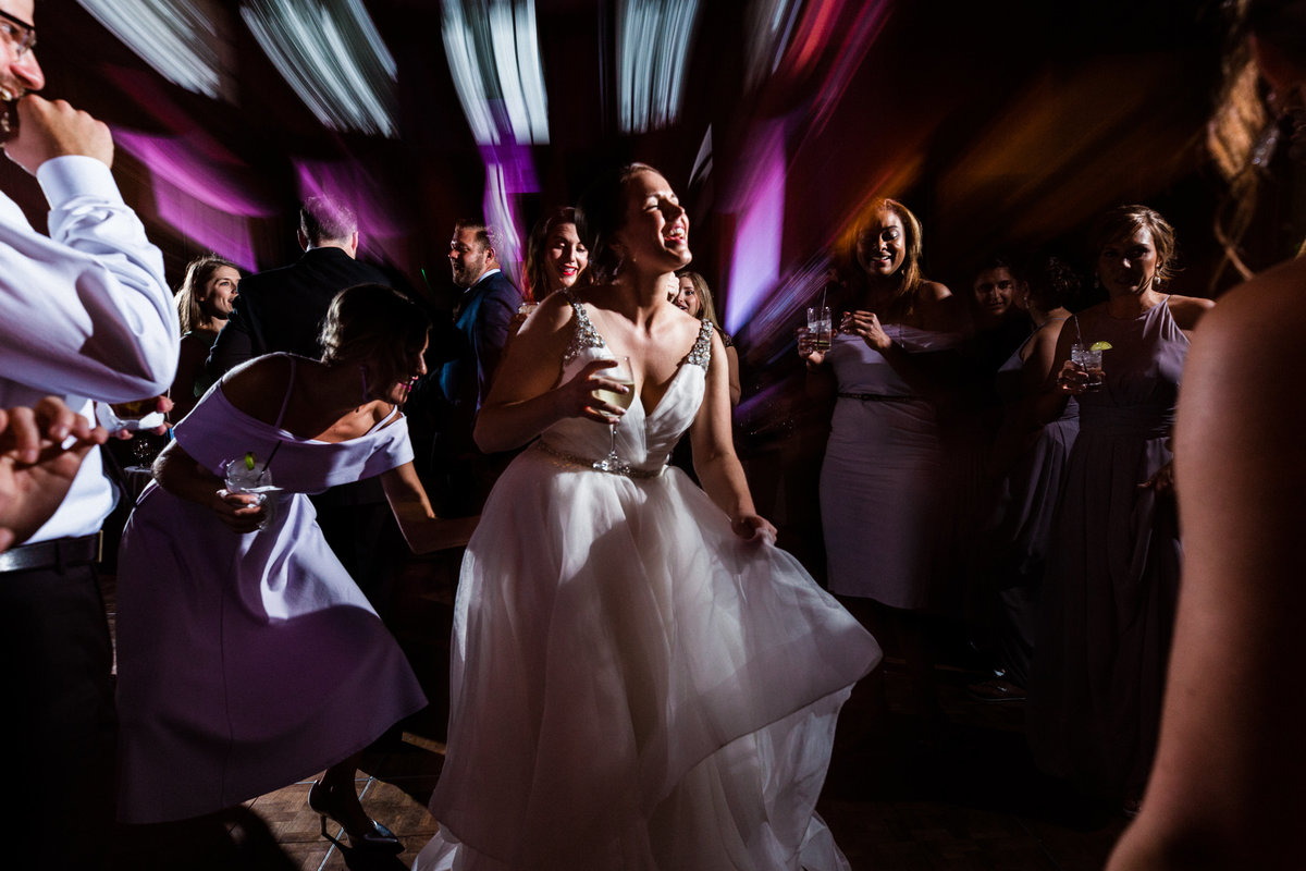 A bride breaks it down on the dancefloor as the party unfolds