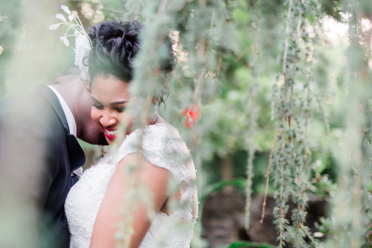 Bride and groom laughing during outside portraits at Riverdale Manor Wedding
