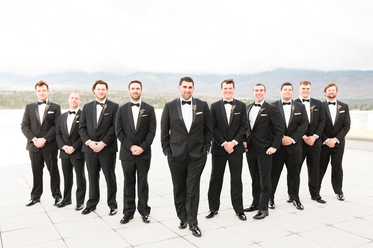 groom and groomsmen standing in a line