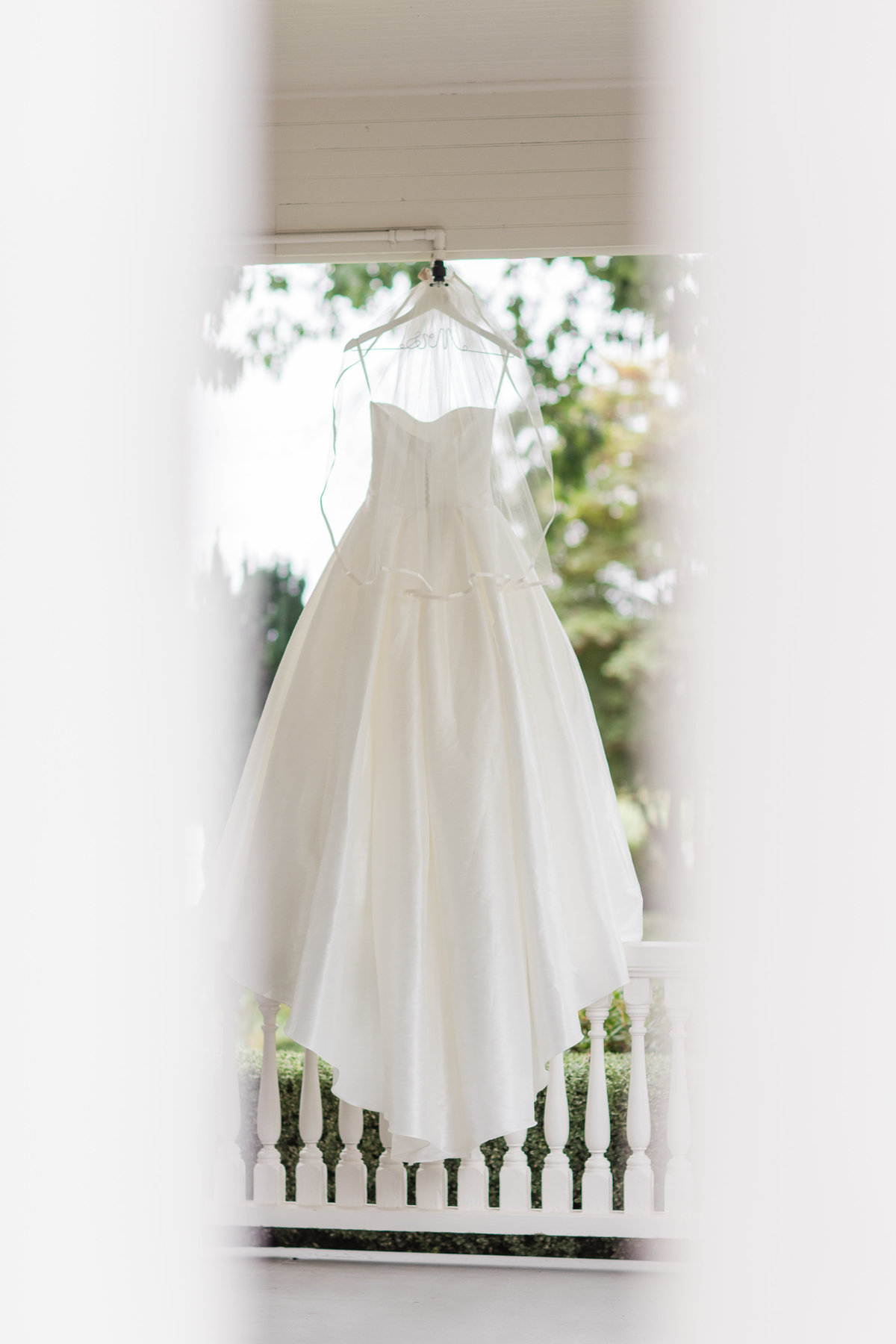 Wedding Dress on Porch of Maplehurst Farms Wedding Venue