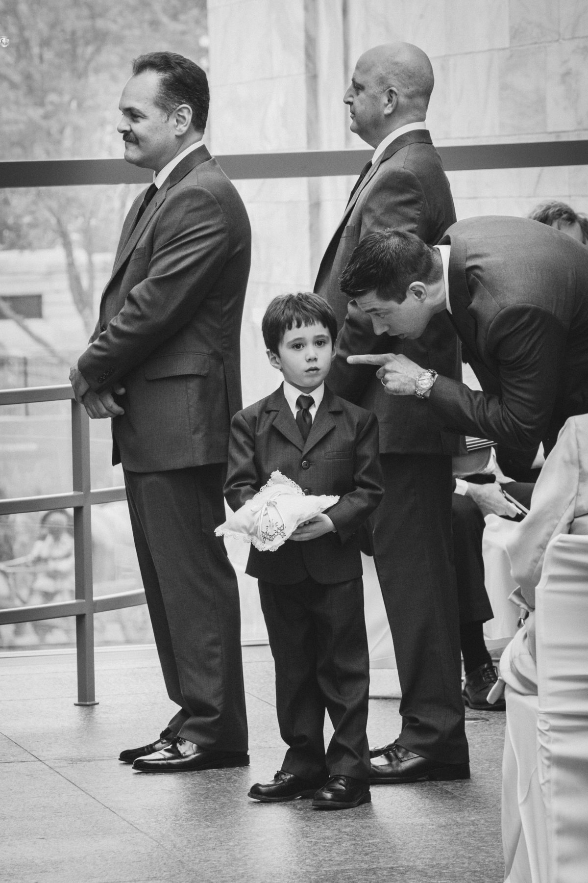 Kid getting in trouble during ceremony