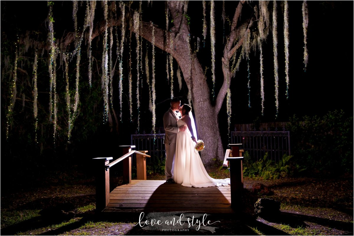 Bakers Ranch Wedding Photography of the bride and groom backlit under the tree with twinkle lights