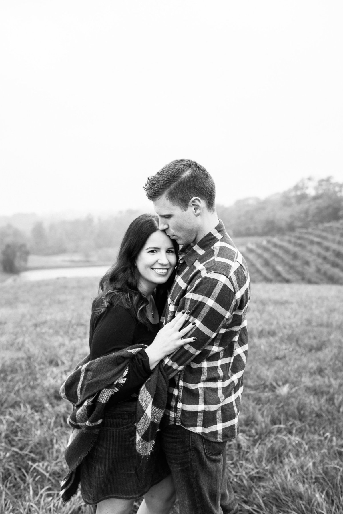 A couple embraces each other during a light rain at a winery in Cincinnati, Ohio