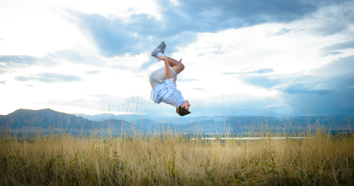Boy doing back flip at Davidson Mesa