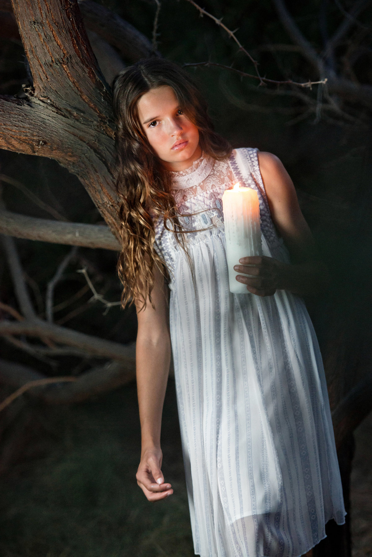 girl with candle editorial