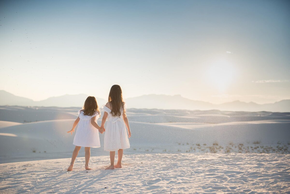 White Sands New Mexico little girls holding hands