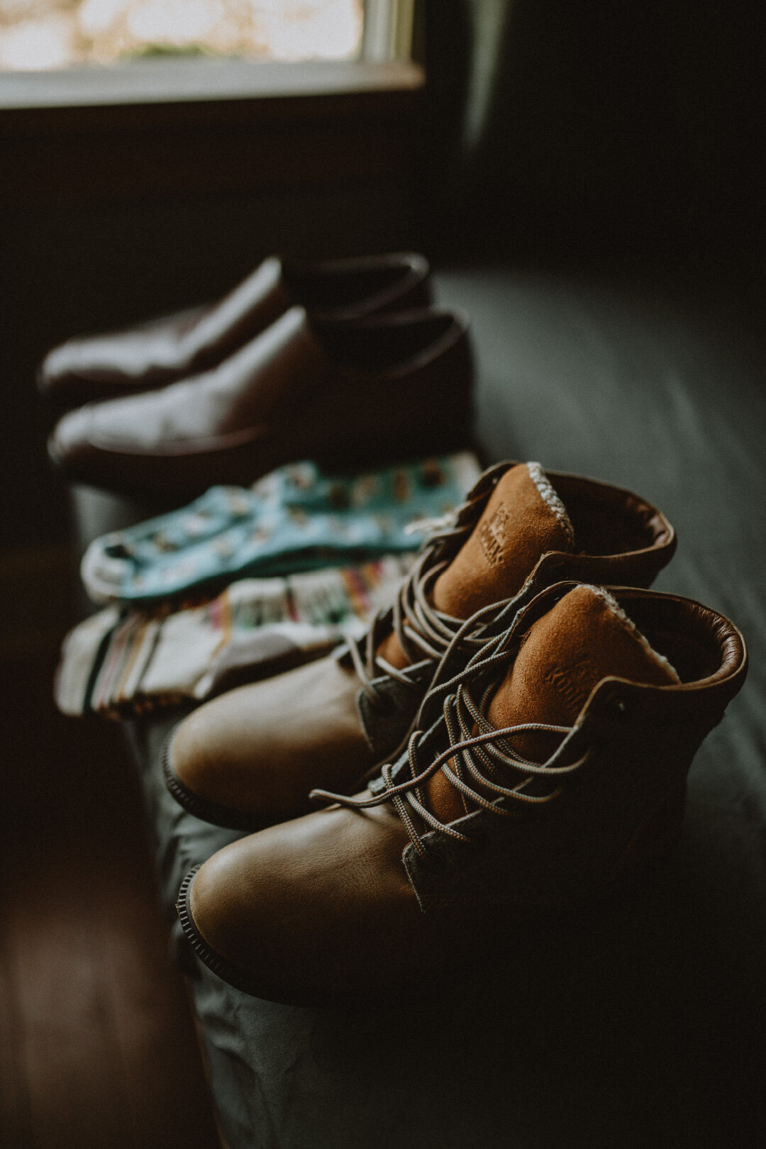 Hiking boots lined up in macro shot before elopement wedding day