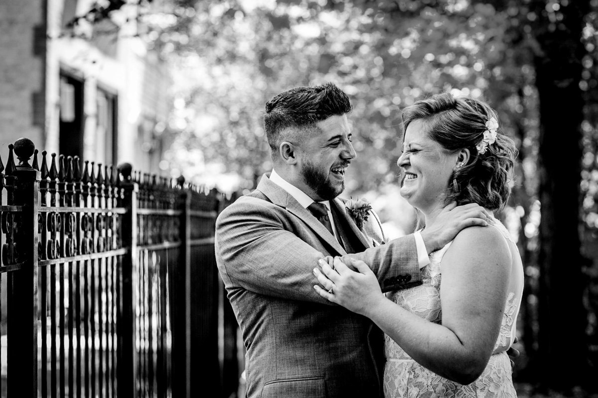 A couple laughs together before their Bottom Lounge wedding ceremony.