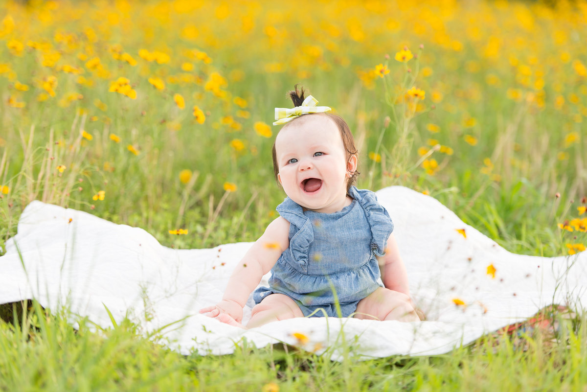 Baby girl in a field of wildflowers