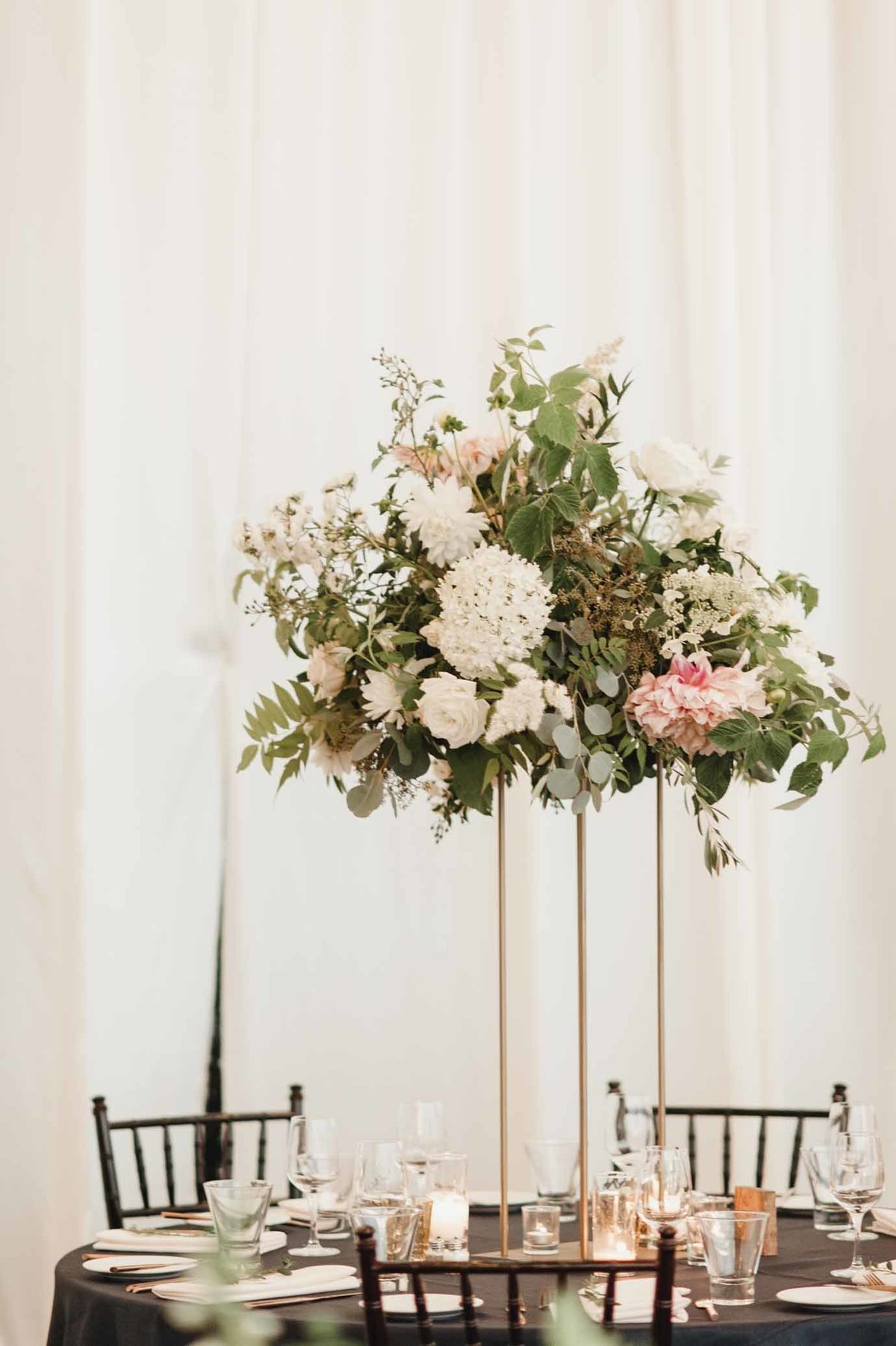 Romantic cream, green and blush elevated wedding floral arrangement created for our luxe Seattle wedding