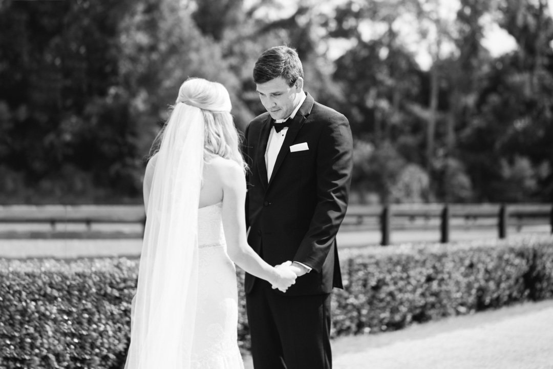 An emotional groom looks at his bride before being wed at Legacy Lookout at Foxhall