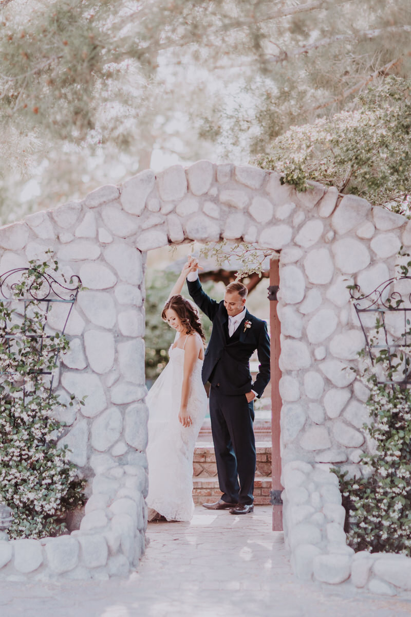 Lake Tahoe elopement photographers groom dances with bride in doorway