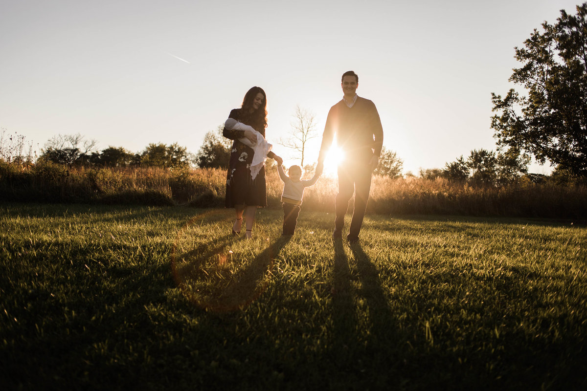 Family of four walking during a sunset session with Elle Baker Photography