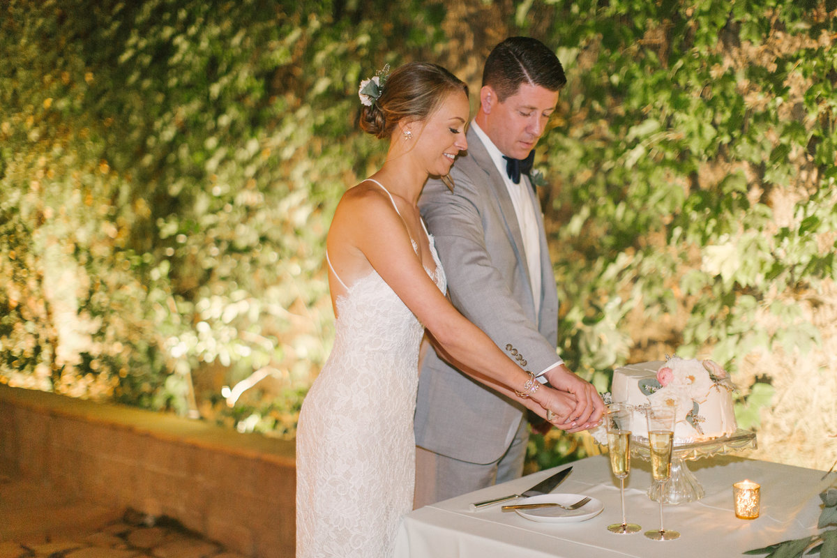 Bride and groom cut the cake at Firestone Vineyard wedding