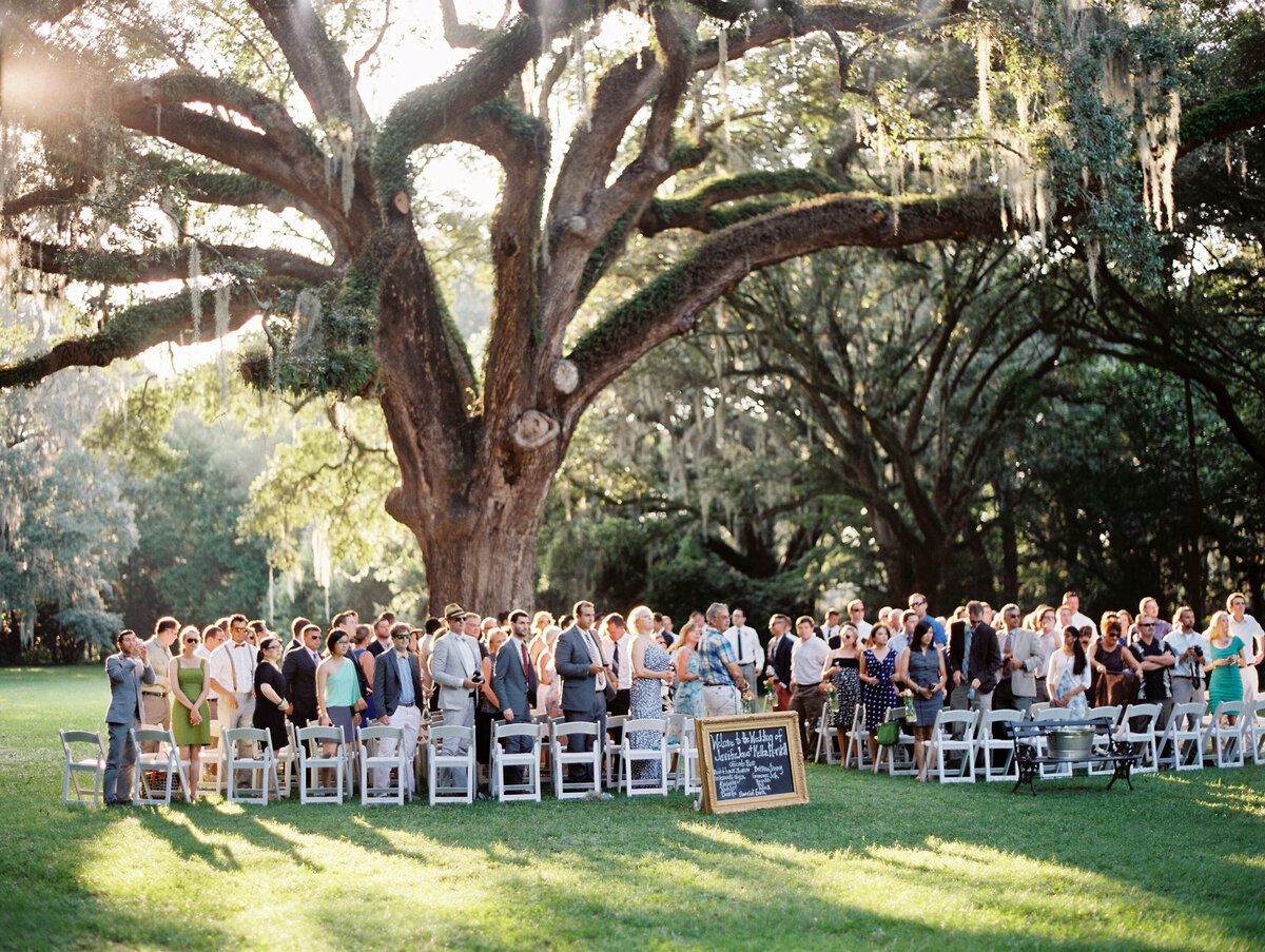 Wedding Ceremony under oak tree at Legare Waring House