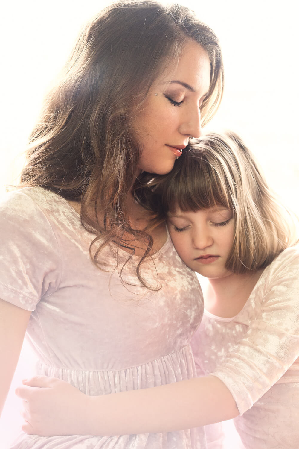 Calm moment for mother and daugther in mother daughter photoshoot