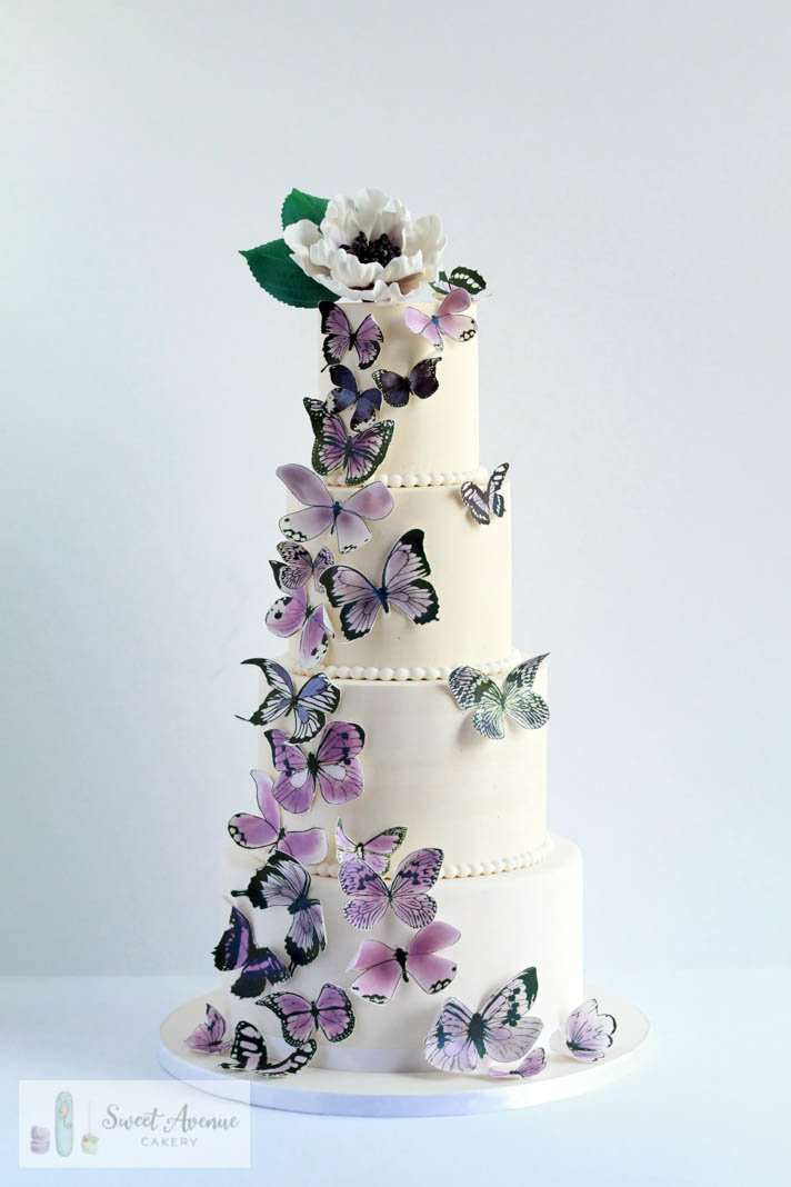 four tier white buttercream wedding cake with butterflies cascade, Hamilton ON wedding cakes