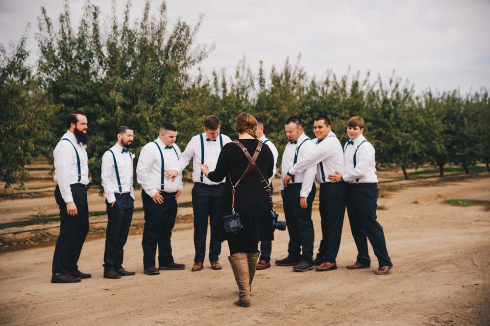 fresno wedding photographer megan helm prepping groomsmen for portraits
