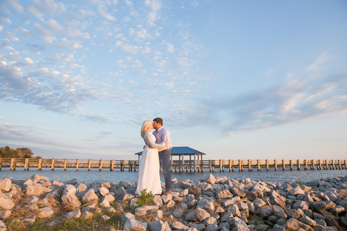 Engagement portrait on the rocks at beach in south Mississippi Biloxi