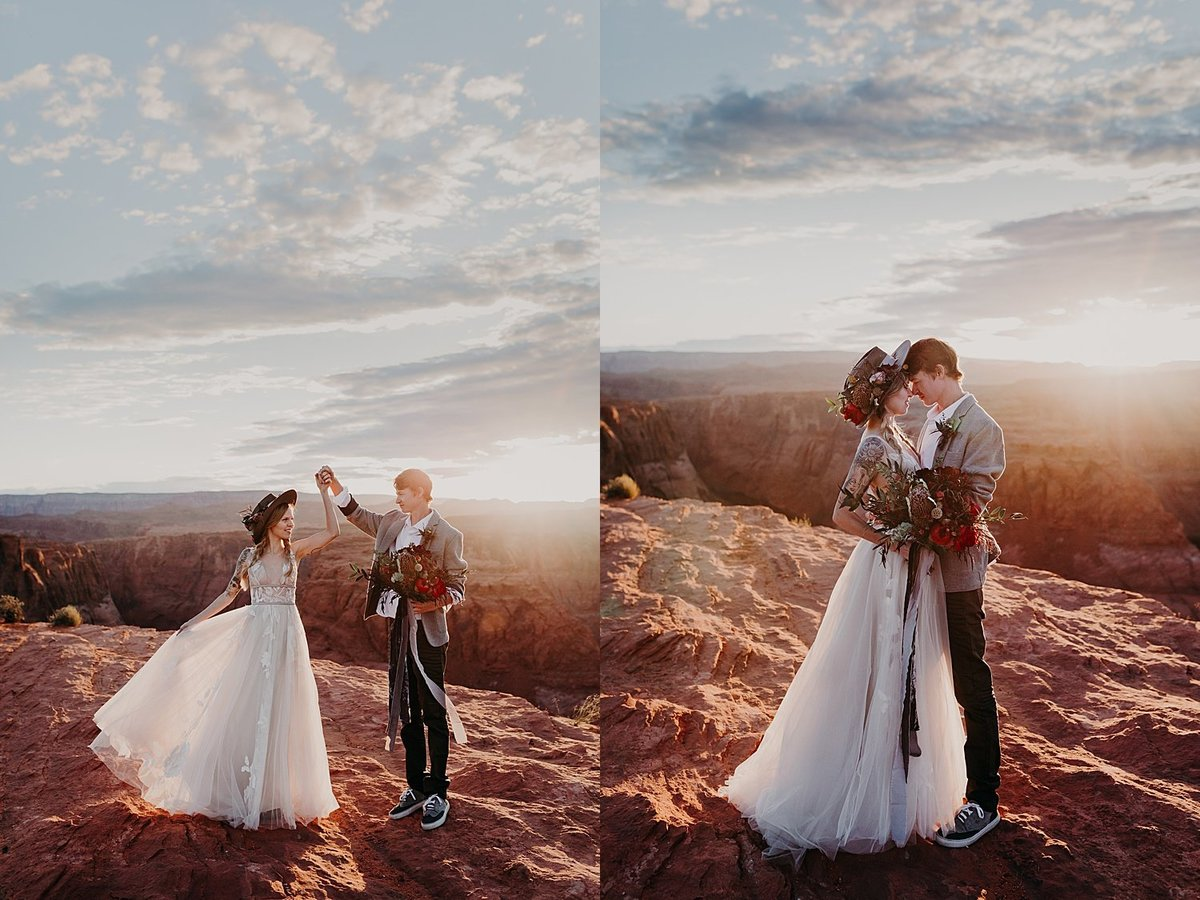 groom twirls bride in a flowered hat along the edge of a cliff in Page, Arizona