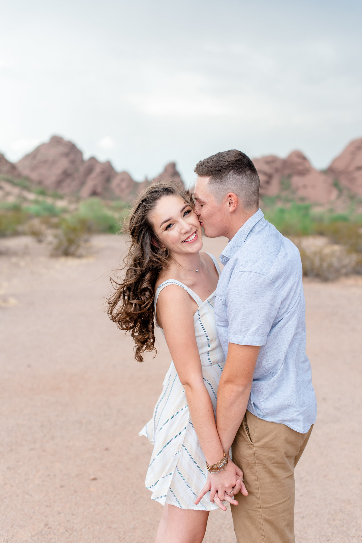 boy kisses girls cheek at papago park