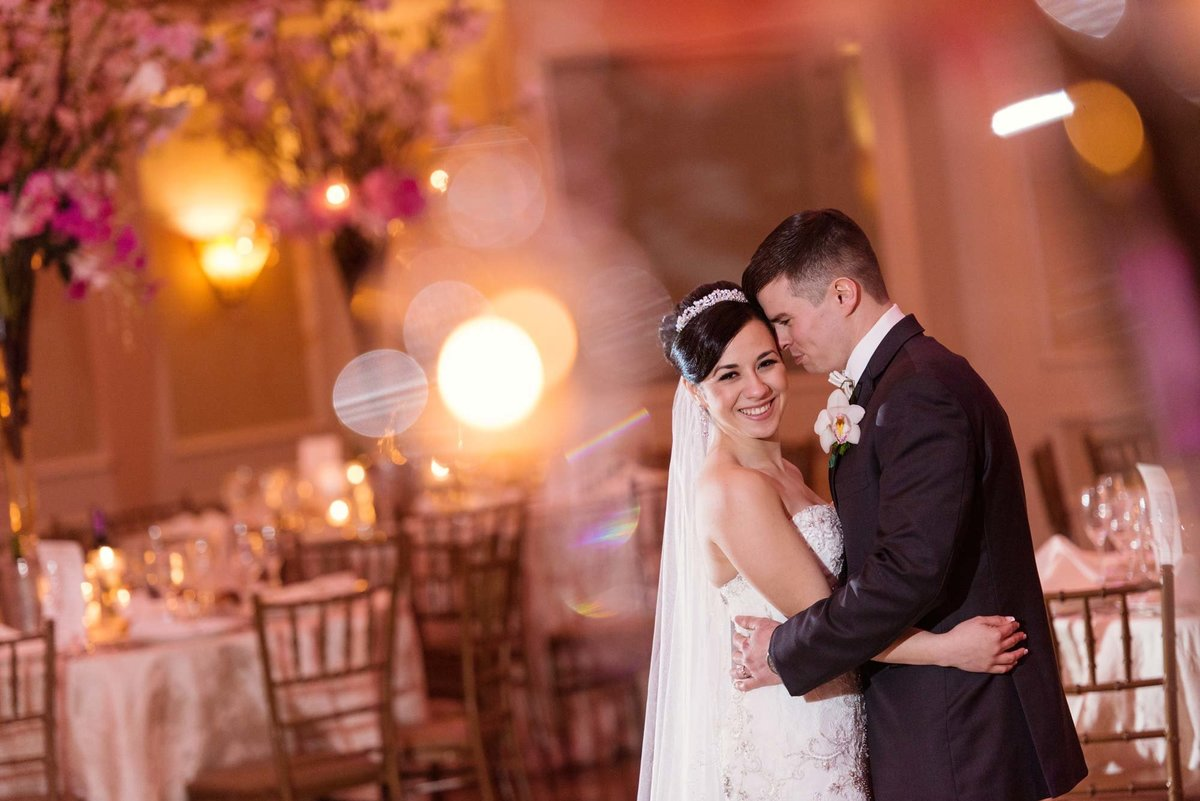 Groom kissing his bride at the ballroom of Larkfield Manor