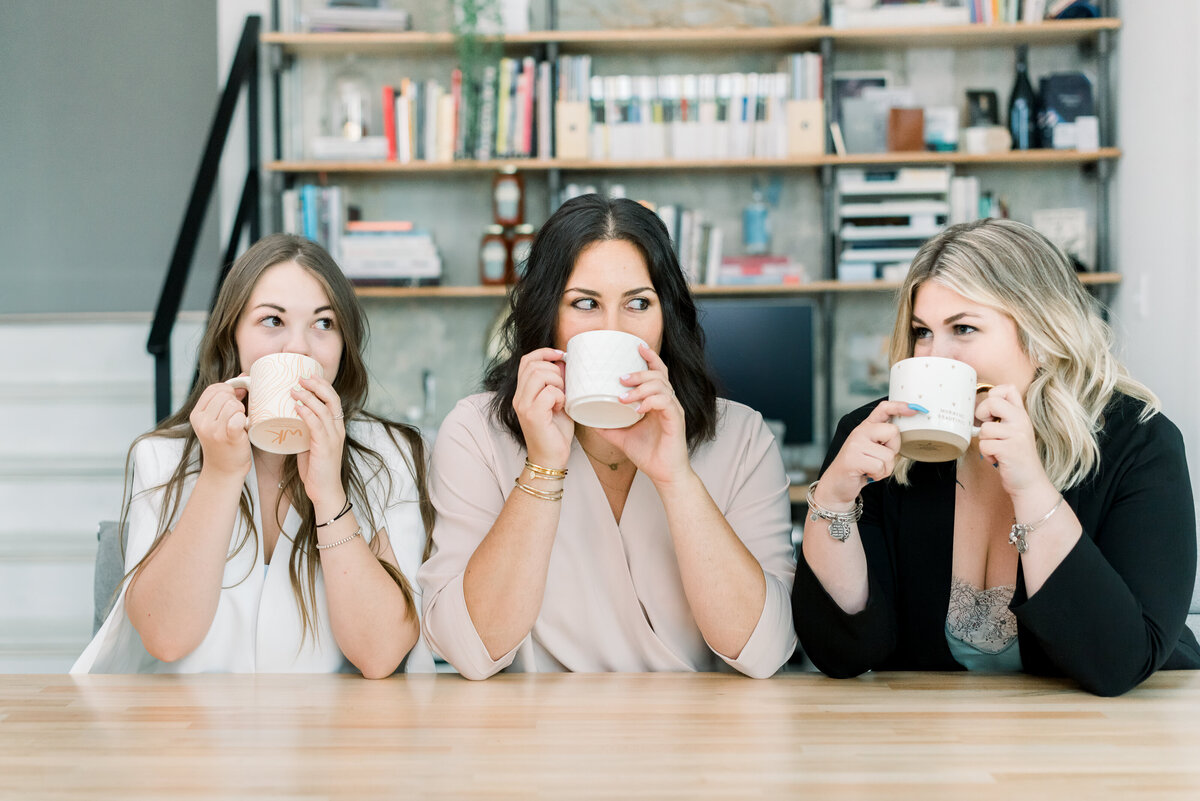 three women drinking coffee