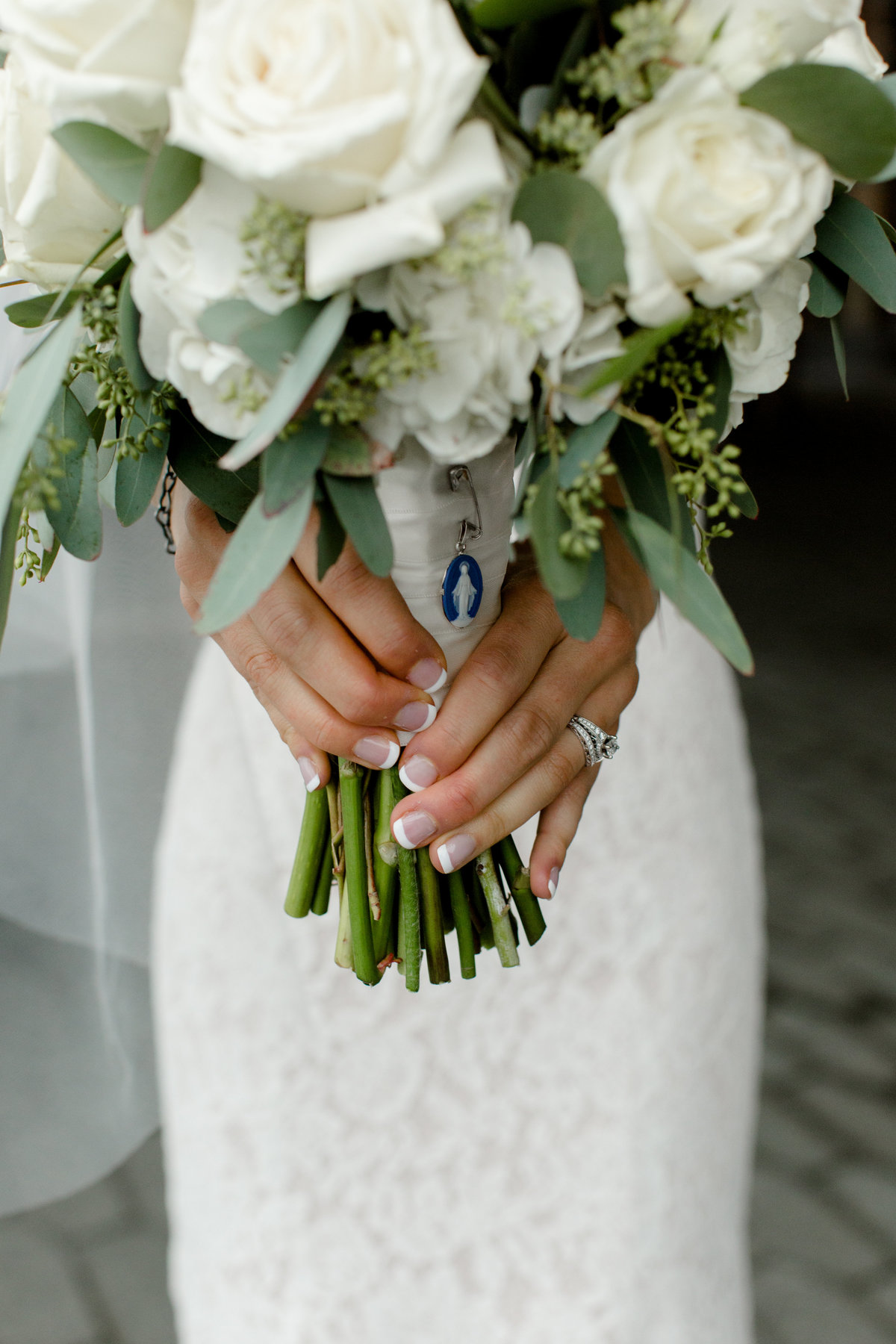 Catholic image of Mary wrapped around bouquet - unique ways to incorporate faith into wedding day
