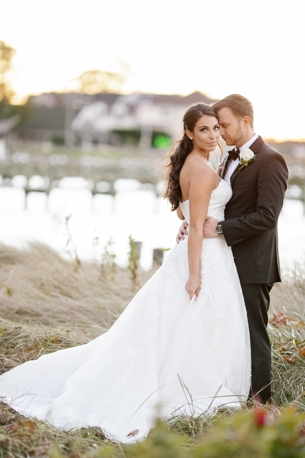 bride and groom by dock at clarks landing yacht club wedding