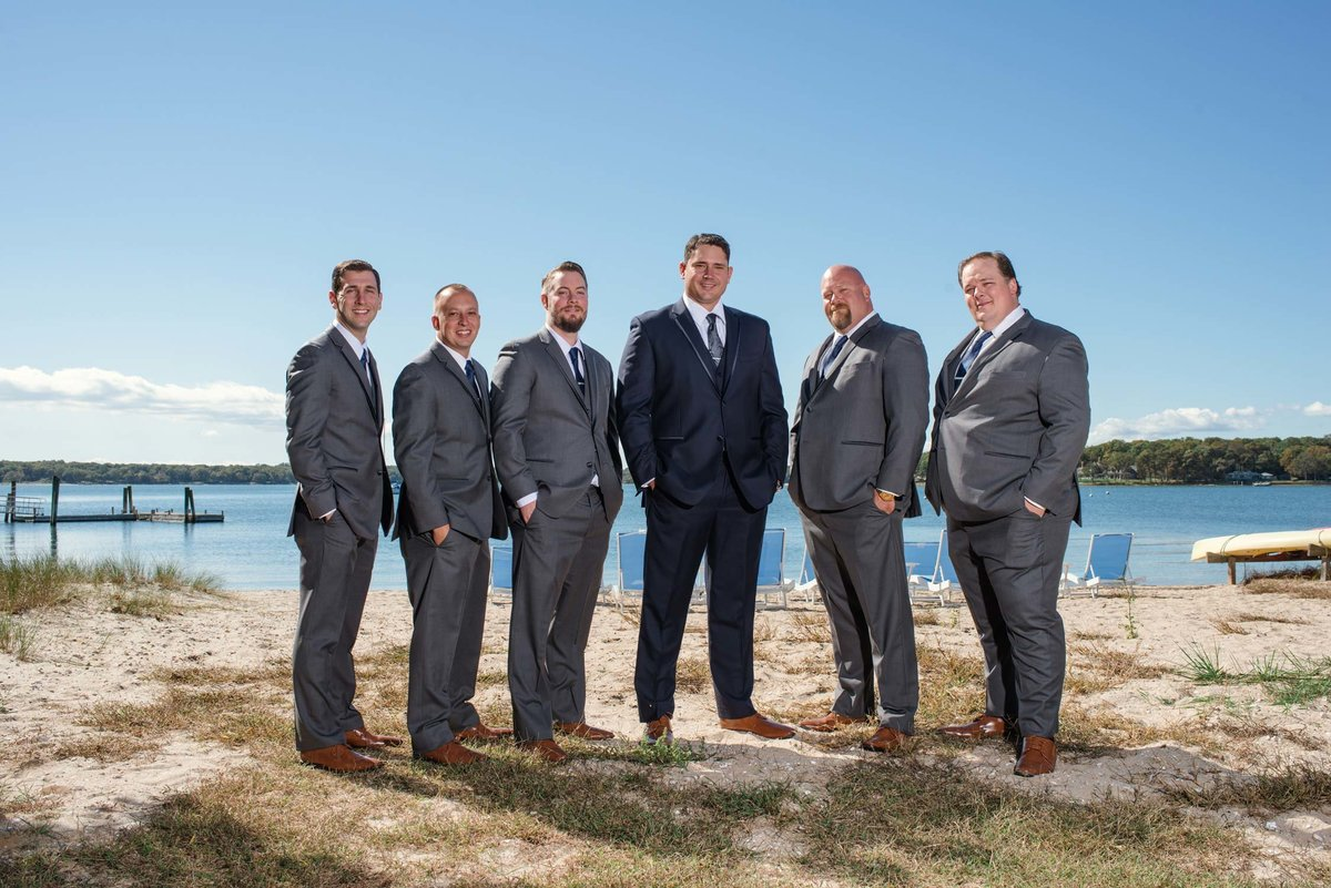 Groom and groomsmen by the water at The Ram's Head Inn