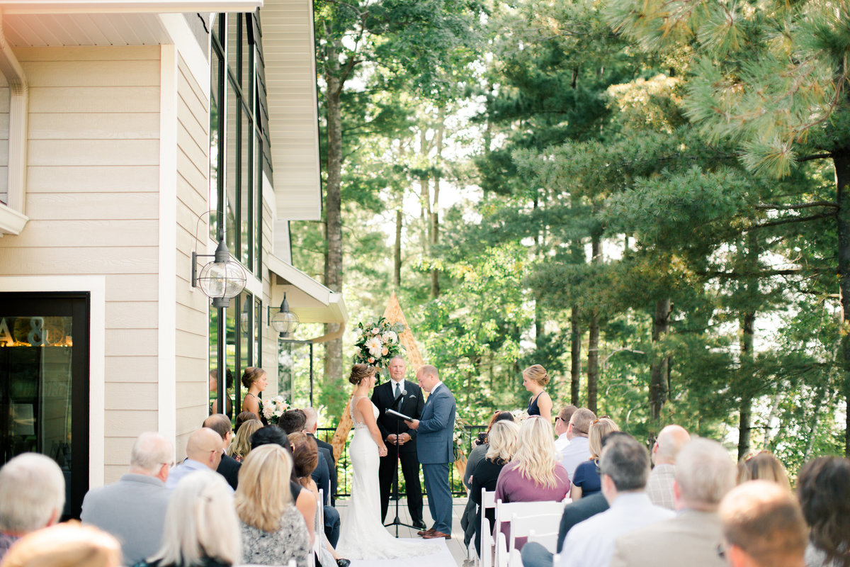 backyard dec wedding ceremony over gull lake brainerd minnesota