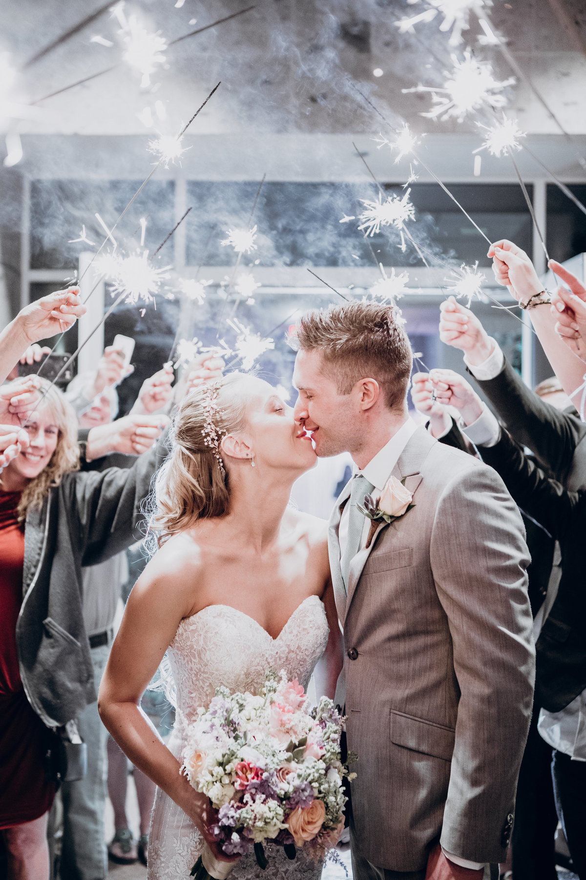 Lake Tahoe wedding pictures bride and groom kiss under sparklers