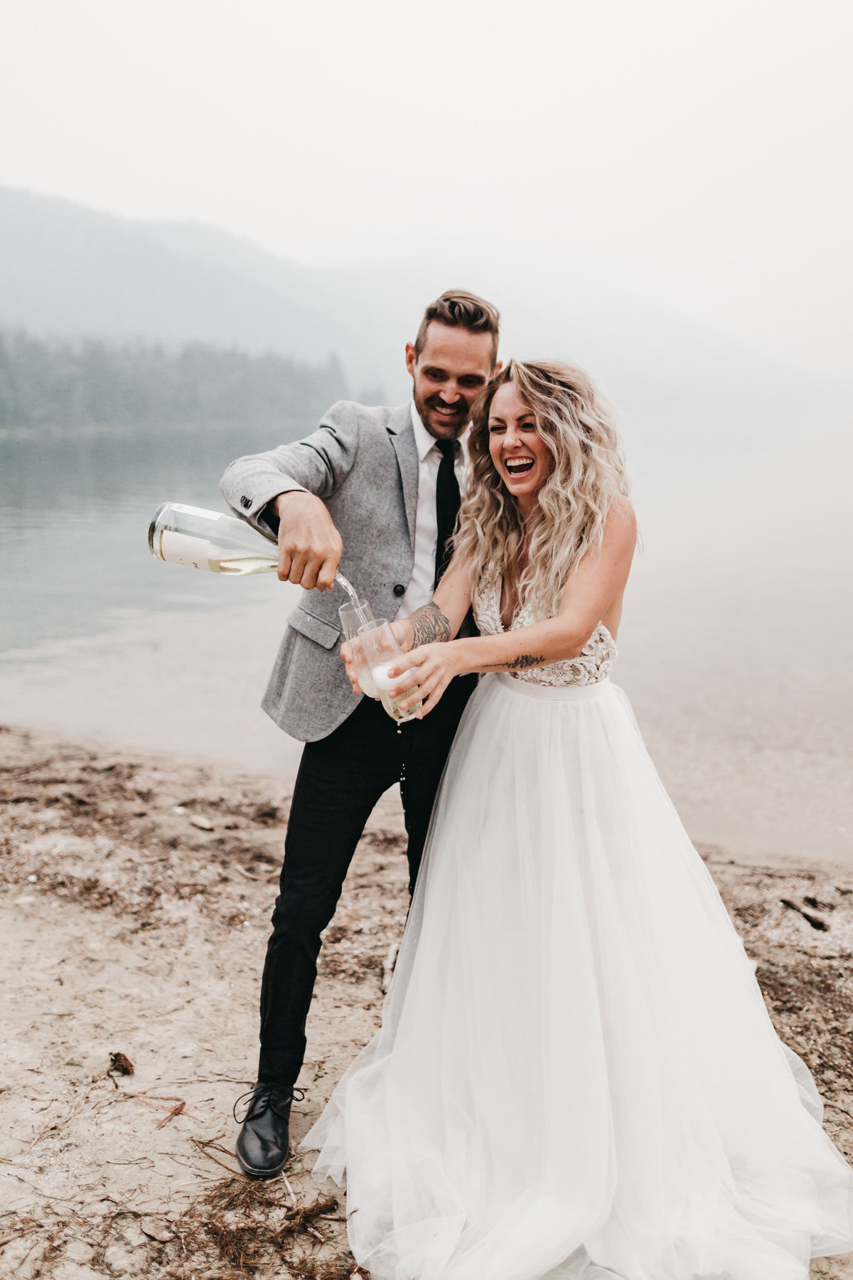athena-and-camron-sara-truvelle-bridal-wenatchee-elopement-intimate-45-champagne-pop-bride-groom-fun-drink