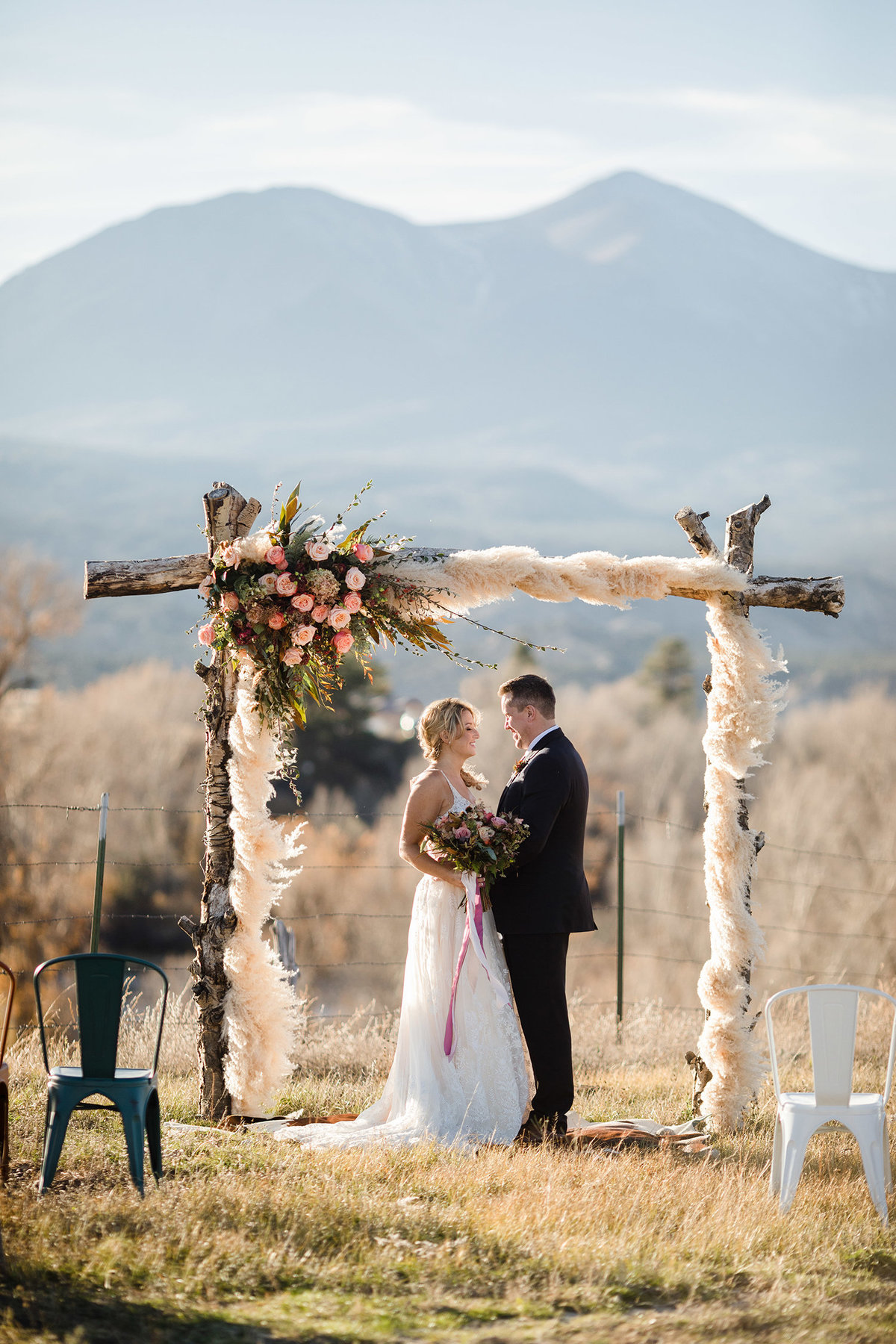 Everett Ranch Rocky Mountain Wedding Outdoor Barn Rustic Salida Colorado Alpaca Collegiate Peaks Vintage Ranch Fish Floral Arbor 011