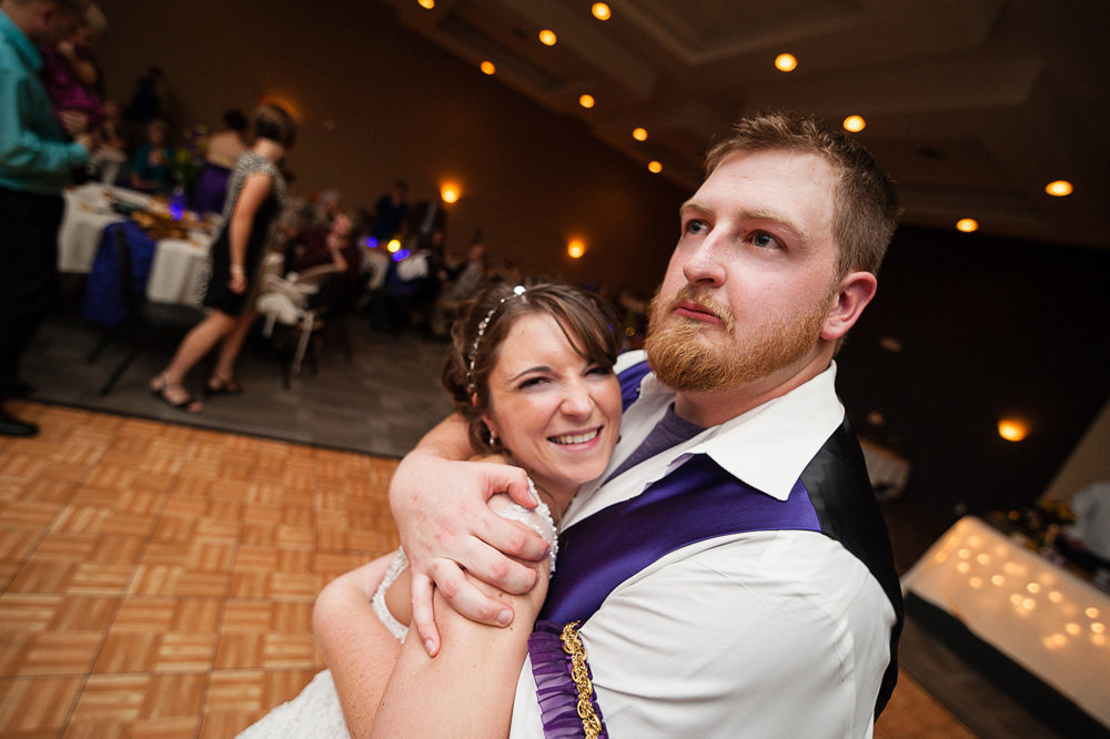 The groom looks wild during one dance with his bride at their reception at the Doubletree Motel in Bloomington, Illinois.