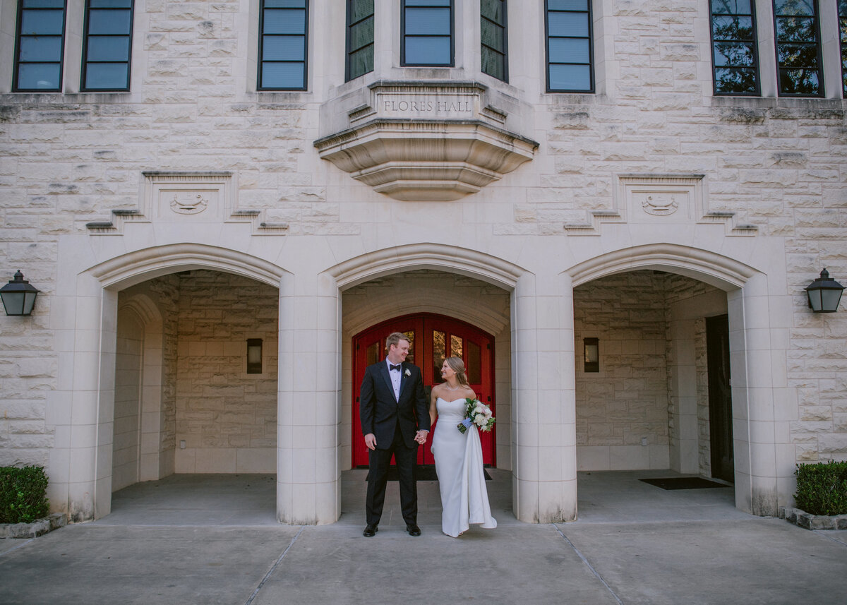 Bride and groom outside St Johns High School Great hall in Houston Texas