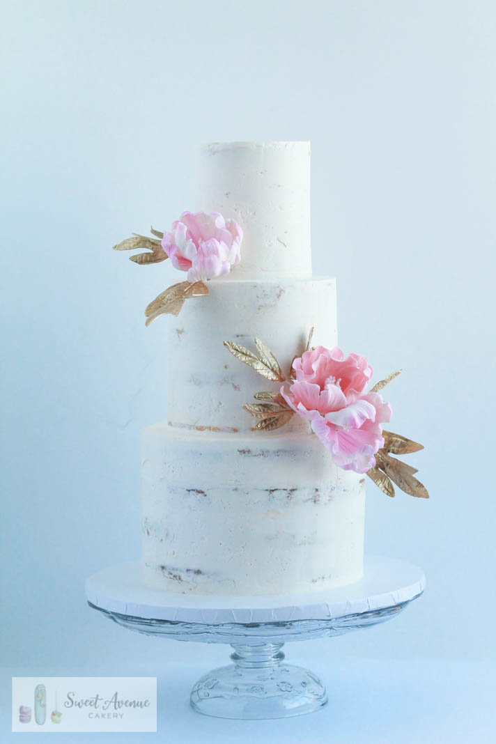 rustic semi naked buttercream with pink and gold flowers, wedding cakes Hamilton ON