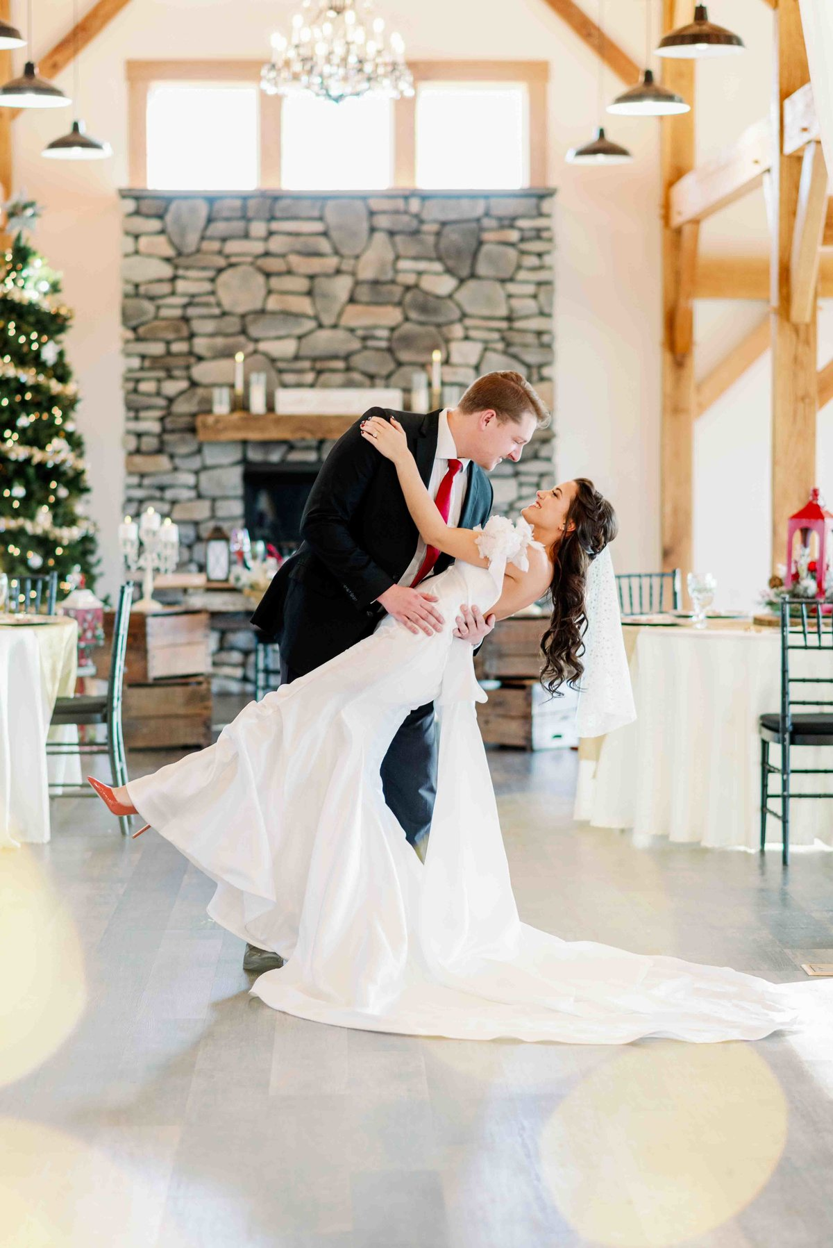 bride and groom celebrating at fox meadow barn christmas wedding