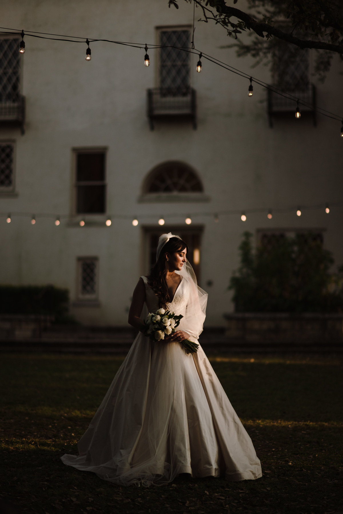bride poses in front of laguna gloria