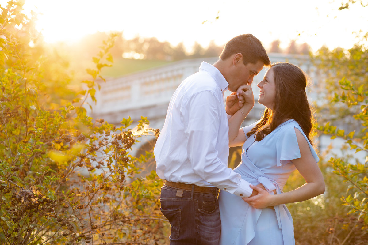 Fall Sunset Maternity Session with blue maxi dress standing by bridge with yellow trees  at Forest Park in St. Louis by Amy Britton Photography Photographer  in St. Louis