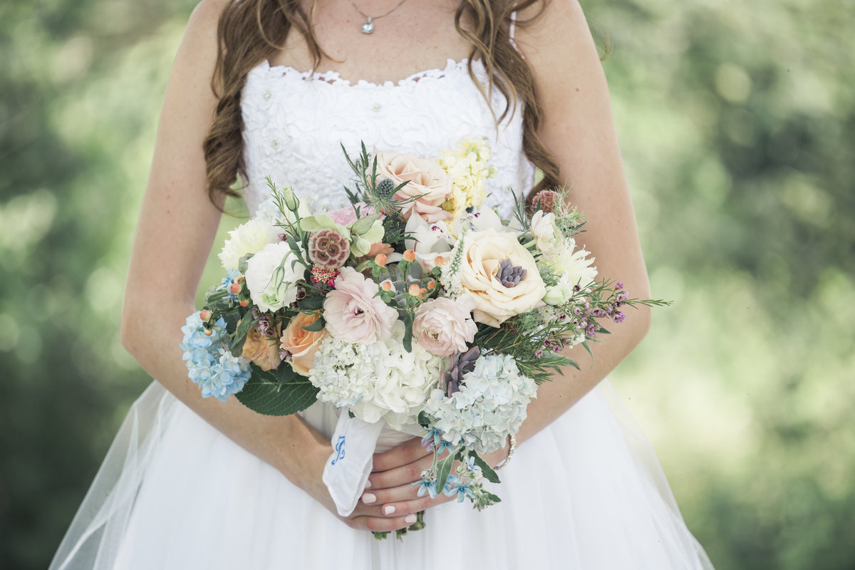 Beautiful, full bridal bouquet at spring wedding in Charlotte NC