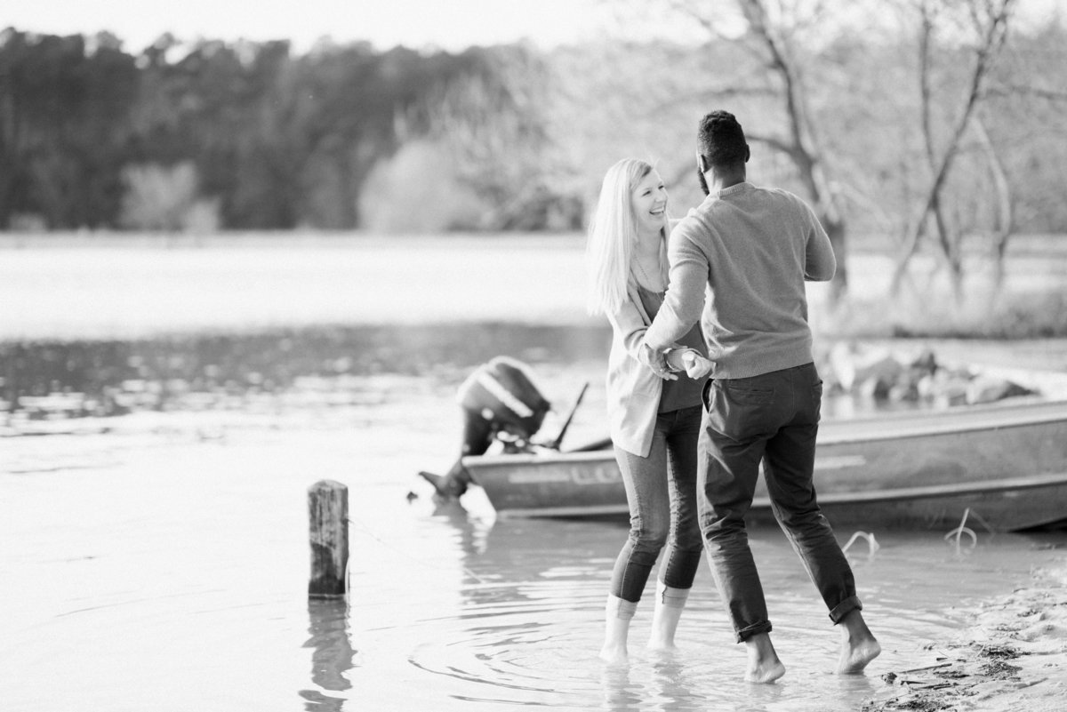 couple wading in lake