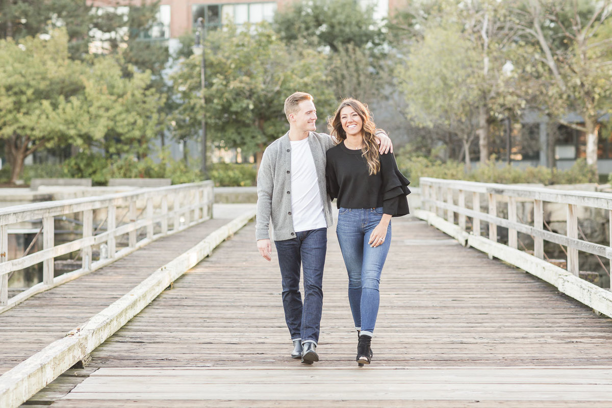 couple walking across a bridge