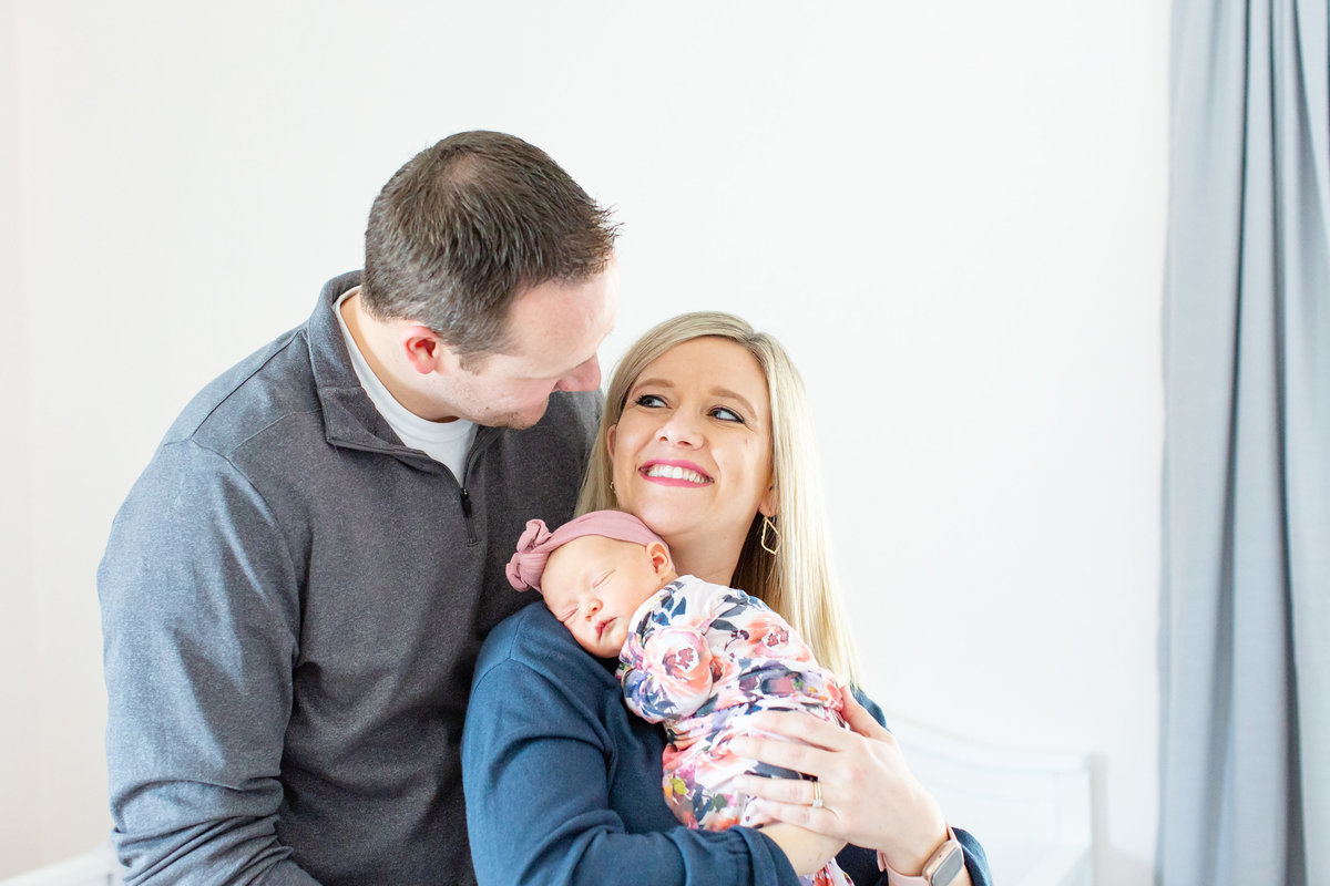 Baby girl Lifestyle Newborn  Session with parents in nursery in St. Louis by Amy Britton Photography Photographer  in St. Louis