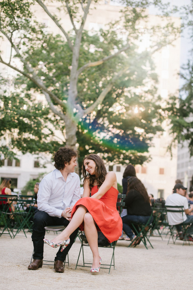 Happy Couple in Bryant Park in NY during their summer engagement session