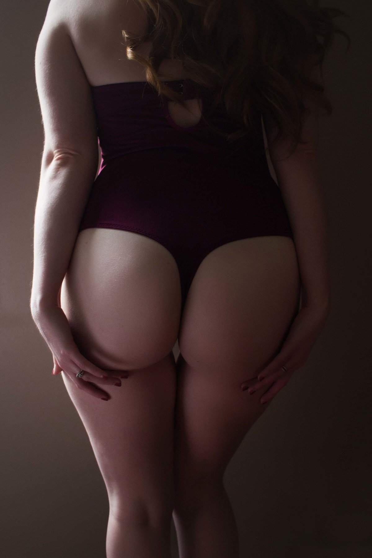 plum thong body suit