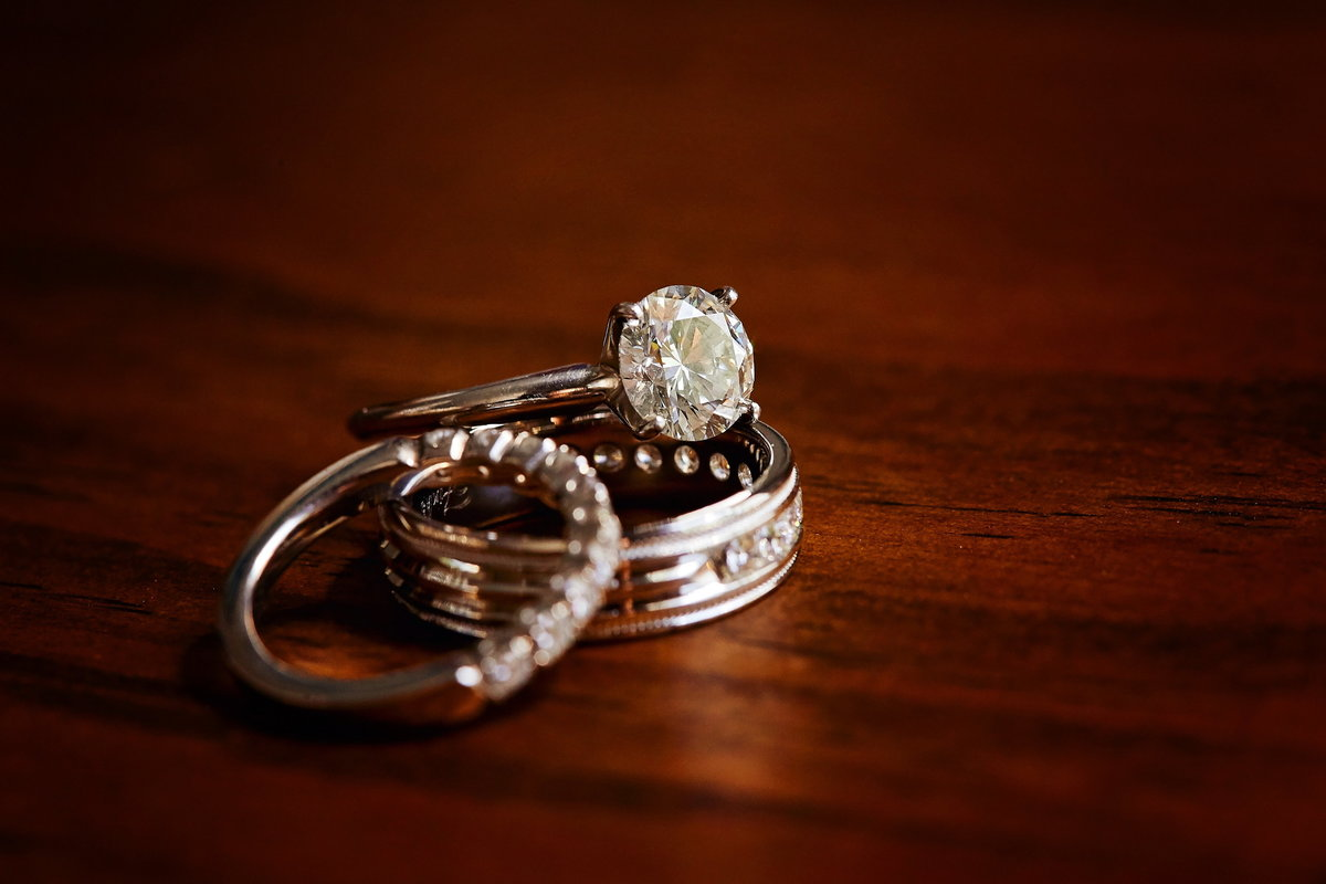 Round diamond engagement ring with gold and diamond wedding bands in Charleston, SC